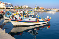 Fishing boats moored at the pier in the marina. Fishing boats moored at the pier in the marina on Cyprus Stock Photo