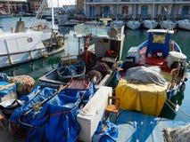 Fishing boats moored in the port of Genoa Genova, Italy stock photo
