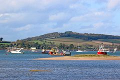 River Exe estuary. Fishing boats moored in the River Exe, Devon Stock Photo