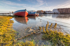 Fishing boats moored on the River Stock Photos