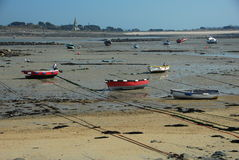 Fishing boats moored on the sand Stock Photo