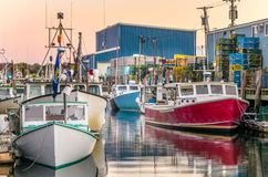 Fishing Boats Moored to the Piers Royalty Free Stock Image