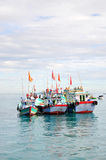 Fishing boats are mooring together in the sea Royalty Free Stock Photos