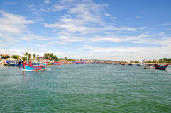 Fishing boats are mooring together in the sea Royalty Free Stock Photography