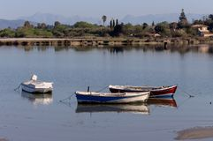 Fishing boats in the morning light. Old, wooden, fishing boats on the lake Halkiopoulou on a spring day Corfu Island, Greece Stock Photography