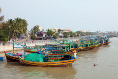 Fishing boats and Mui Ne town Stock Photo