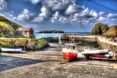 Fishing boats Mullion Cove harbour Cornwall UK in colourful bright HDR Royalty Free Stock Image