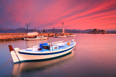 Fishing boats in Nafplio. Fishing boats and Bourtzi castle in the Nafplio harbour in Peloponnese peninsula, Greece Royalty Free Stock Photos