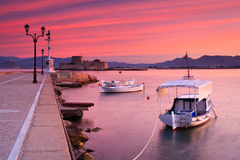 Fishing boats in Nafplio. Fishing boats and Bourtzi castle in the Nafplio harbour in Peloponnese peninsula, Greece stock photography