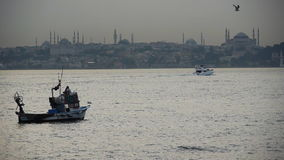 Fishing boats near Hagia Sophia stock footage