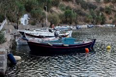 Fishing boats are near the shore. View of the embankment of the city Saint Nicholas, fishing boats and a sea lake fon a cloudy day island Crete, Greece Royalty Free Stock Photos