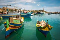 Fishing boats near village of Marsaxlokk Royalty Free Stock Photos