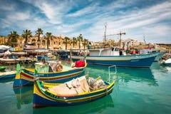 Fishing boats near village of Marsaxlokk Royalty Free Stock Photo