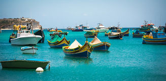Fishing boats near village of Marsaxlokk Stock Photo