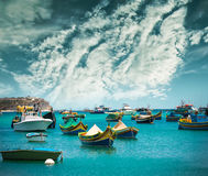 Fishing boats near village of Marsaxlokk Stock Photos