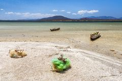 Fishing boats and net. In the Anony salted lake near Tolanaro & x28;Fort-Dauphin& x29; in southern Madagascar stock images
