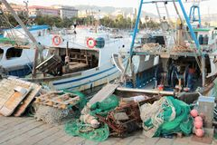 Fishing boats and nets. Fishing boats and equipment such as nets in the Italian port of La Spezia royalty free stock image