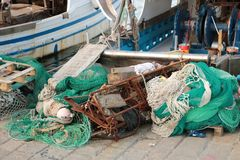 Fishing boats and nets. Fishing boats and equipment such as nets in the Italian port of La Spezia stock photos