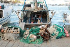 Fishing boats and nets. Fishing boats and equipment such as nets in the Italian port of La Spezia stock images