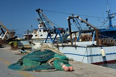 Fishing boats and nets in Trani, Apulia, Italy. View of the old port. Stock Photos