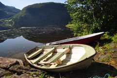 Fishing boats in Norway. Two fishing boats next to a placid lake in the mountains, Norway fiords Royalty Free Stock Photography