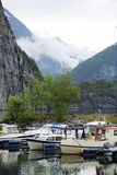 Fishing boats in Norway fjord. Foggy mountains on background royalty free stock photos