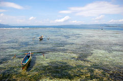 Fishing boats at ocean bay near coast Indonesia Stock Photos