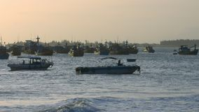 Fishing Boats in Ocean Bay Waves after Hurricane at Sunset. Pictorial view on fishing boats on ocean bay water and waves after powerful hurricane against sunset stock video footage