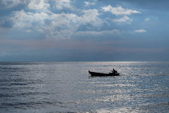 Fishing boats. In the ocean at dusk Royalty Free Stock Image