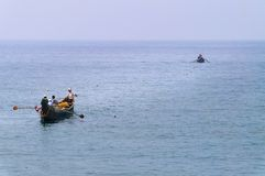 Fishing boats in the ocean Stock Images