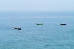 Fishing boats in the ocean. Traditional wooden fishing boats in the ocean. Kovalam. Kerala. India stock images