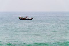 Fishing boats in the ocean. Traditional wooden fishing boats in the ocean. Kovalam. Kerala. India royalty free stock image