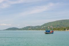 Fishing boats off the coast are returning to the coast. royalty free stock photography