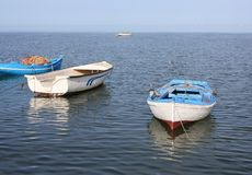 Fishing boats in the old harbor. Old fishing boats at the old harbor of Houmt Souk/Djerba/Tunisia and the Flamingo Island on the horizon Stock Photo