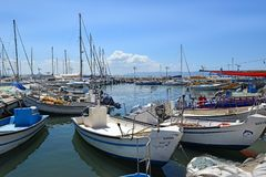 Fishing boats in the old port of Acre, Israel. ACRE, ISRAEL - April 11, 2019: fishing boats in the old port of Acre, Israel royalty free stock photo