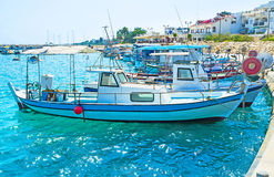The fishing boats. The old fishing boats are waving on the waves in the small port of Zugi village, Cyprus Royalty Free Stock Images