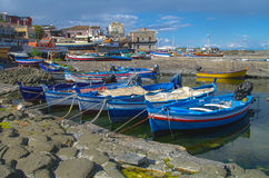 Fishing boats. In one of the harbours of The Cyclops Coast at Sicily, Italy, HDR Stock Photo