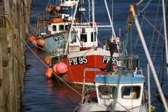 Fishing boats, Padstow, Cornwall, UK. Fishing boats line the harbour wall at Padstow, Cornwall, UK Royalty Free Stock Photo