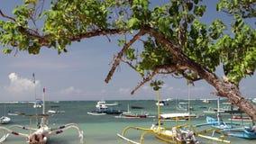 Fishing boats on a paradise tropical island Bali. Sanur beach, Indonesia. stock video footage
