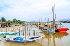Fishing boats park at jetty Stock Photos