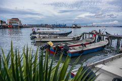 Fishing boats parked along the Chew Jetty fishing village in Penang. Malaysia Royalty Free Stock Photos