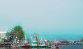 Fishing boats are parked at a small pier in Thailand royalty free stock images