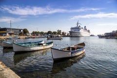Fishing boats and passenger ship Stock Images