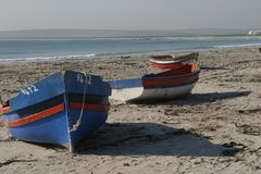 Fishing boats at Patrenoster. Patrenoster is a small village on the Cape West Coast were the fishermen use these small boats for fishing Stock Images