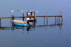 Fishing boats and pier Stock Photo