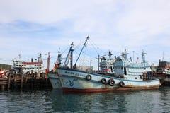 Fishing boats. Pier bluesea  docking Stock Image