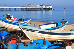 Fishing boats and pier, Cromer. Royalty Free Stock Photography