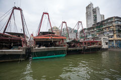 Fishing boats are at the pier at the fishing port in Macau. Stock Photography