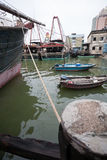 Fishing boats are at the pier at the fishing port in Macau. Royalty Free Stock Photos