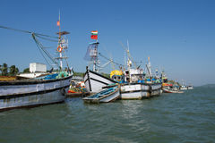 Fishing boats at the pier. Fishing port in southern India stock images